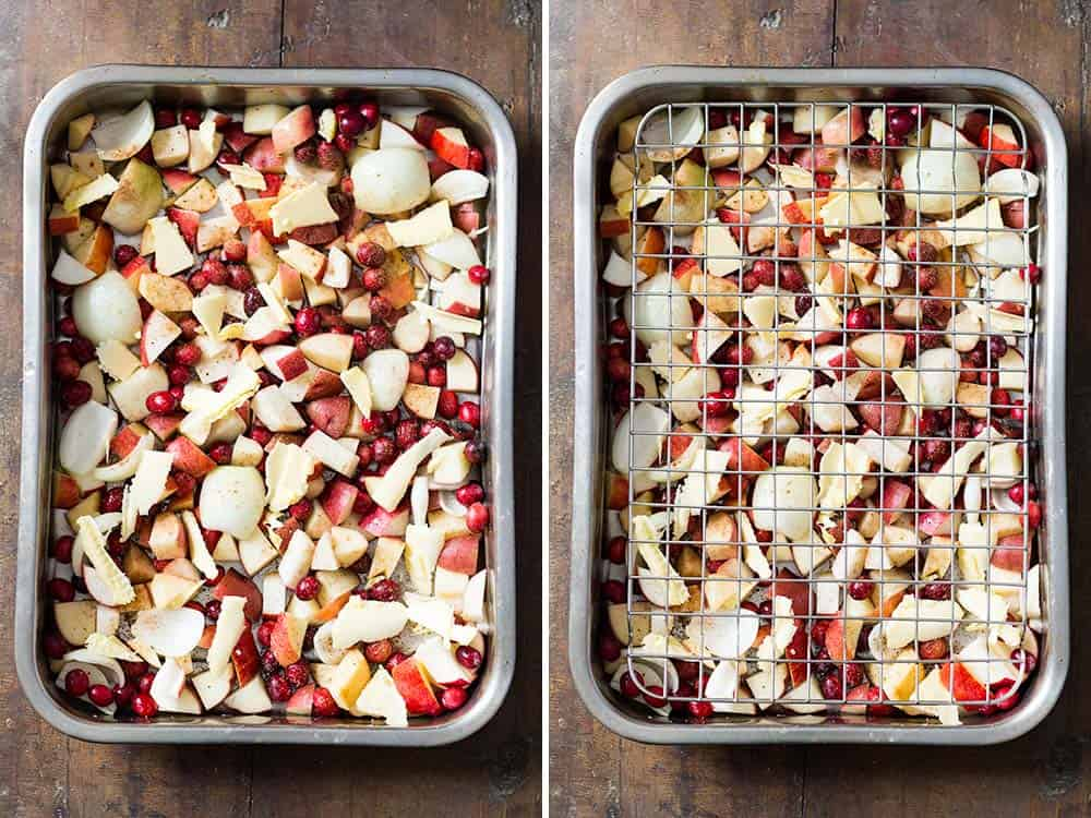 Two roasting pans with chopped raw apples, cranberries and potatoes.