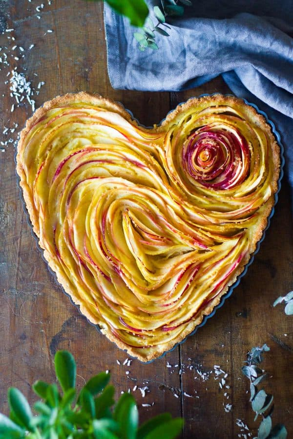 Baked apple tart in heart-shaped tart pan
