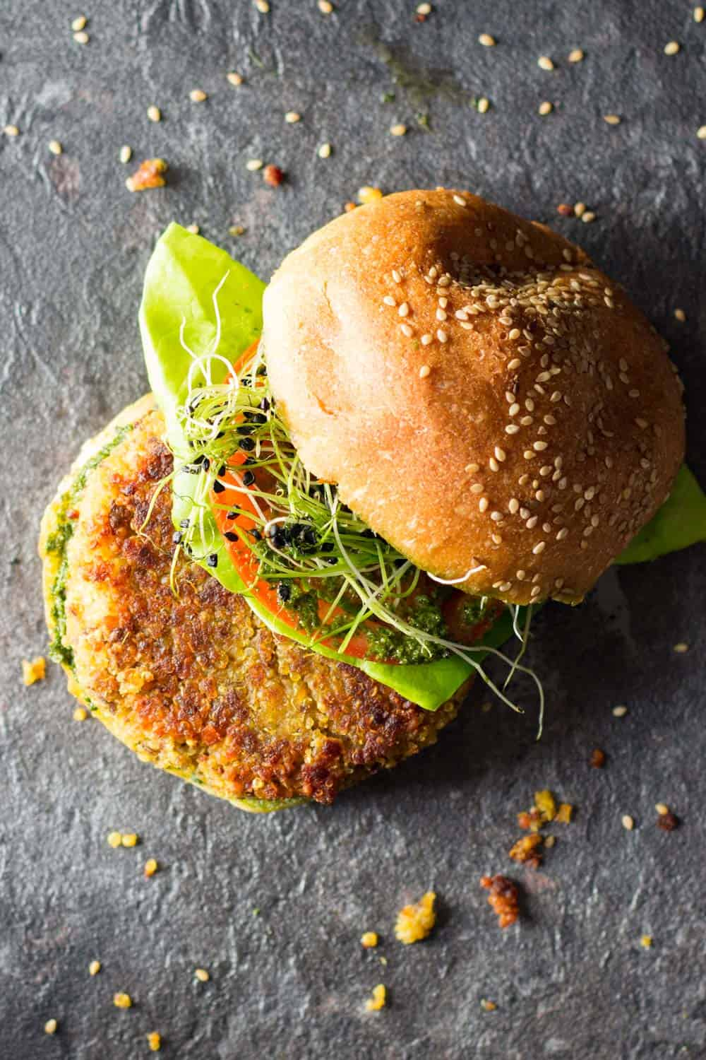 Top view of quinoa burger with top of bun set aside to show ingredients.