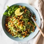 zucchini noodles and roasted chickpeas in a blue bowl