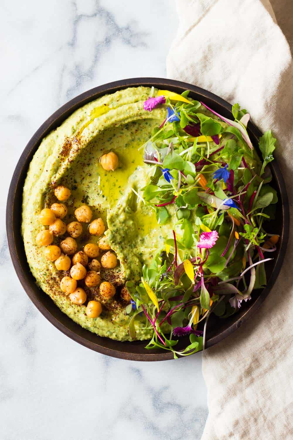 Call it what you want, Avocado Cilantro Hummus, Spicy Avocado Hummus, or 5-minute Hummus, one thing is for sure, this hummus tastes freakin' fenomenal!