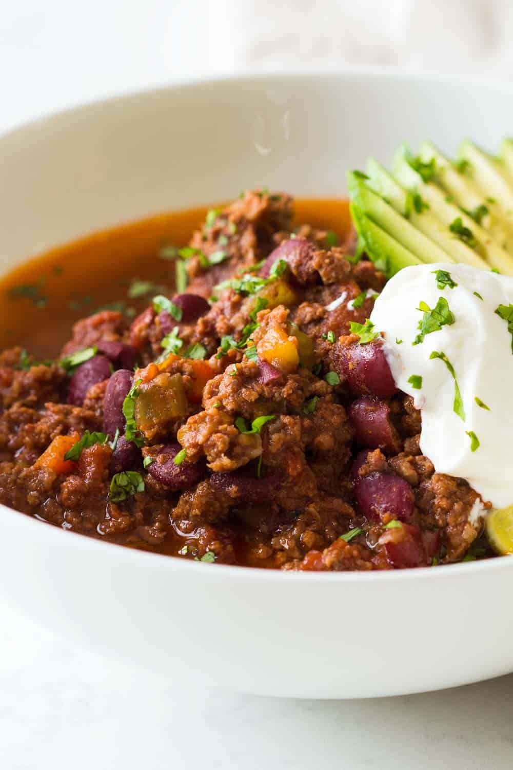 Serve a big crowd in just 45 minutes with this amazing Instant Pot Chili Con Carne. A quick, easy, nourishing and inexpensive meal that makes everybody happy!