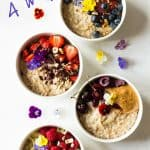 Four Instant Pot Steel Cut Oats bowls with different toppings, garnished with fresh flowers, and text overlay for Pinterest.