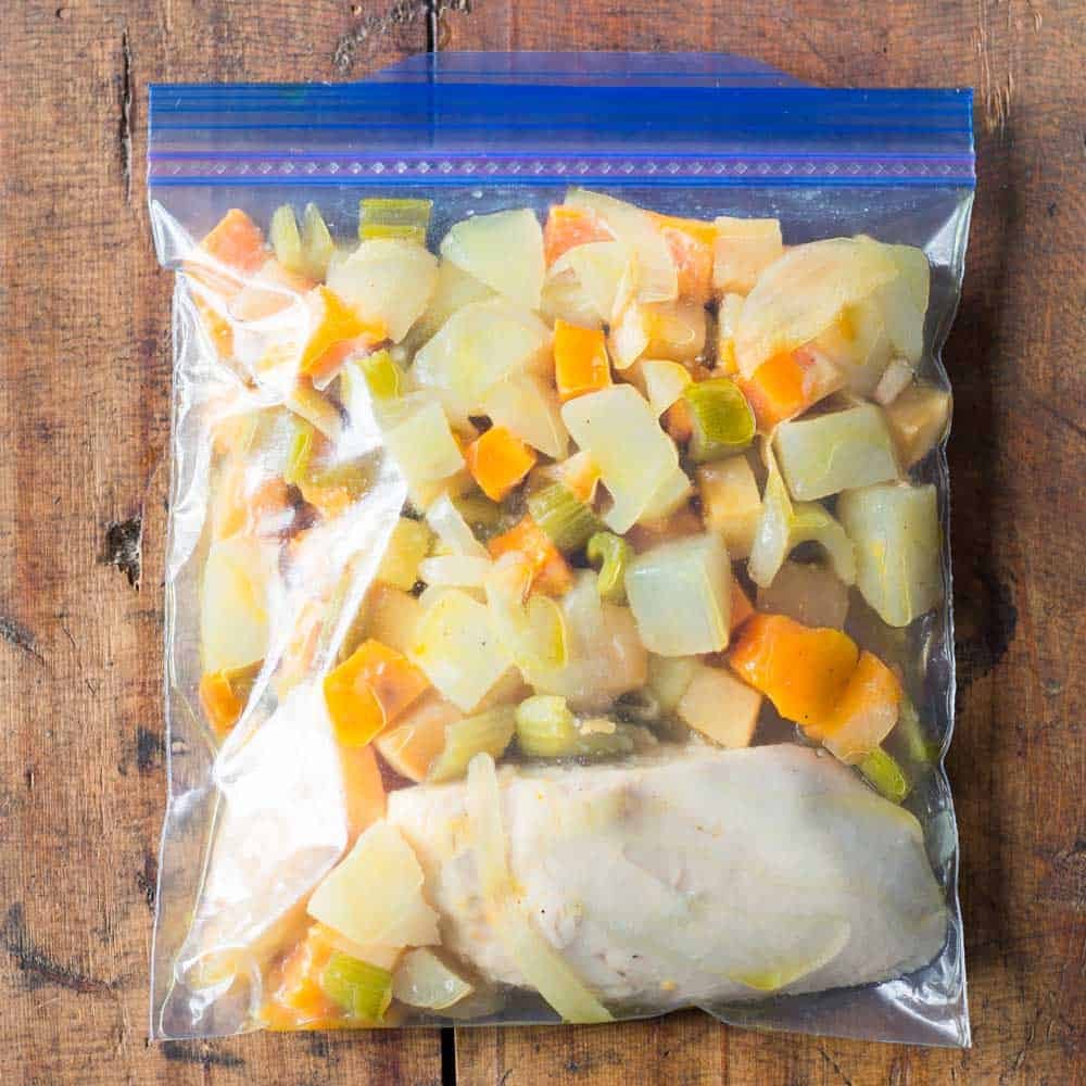 chicken breast with root vegetables as healthy freezer meal in Ziploc bag