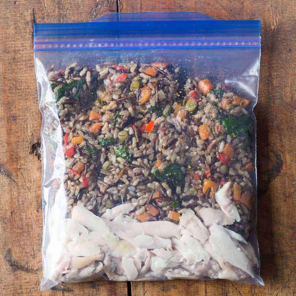 shredded chicken with wild rice blend as healthy freezer meal in Ziploc bag