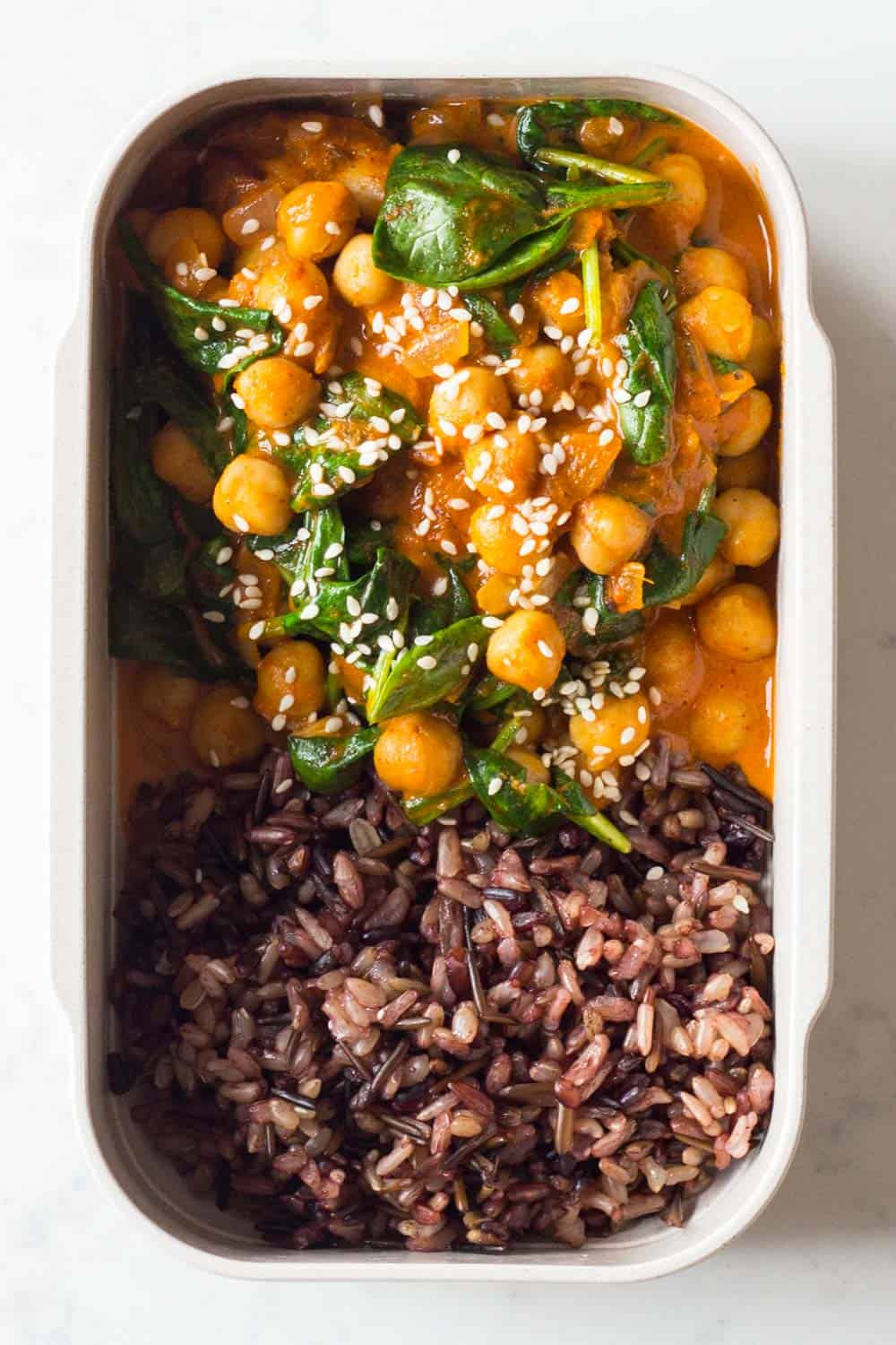 A Vegan Dinner for a Nutritionally-Balanced Vegan Meal Plan - Chickpea Spinach Curry made with coconut milk with wild rice blend on the side.