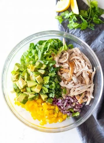 Avocado Chicken Salad deconstructed in a glass bowl