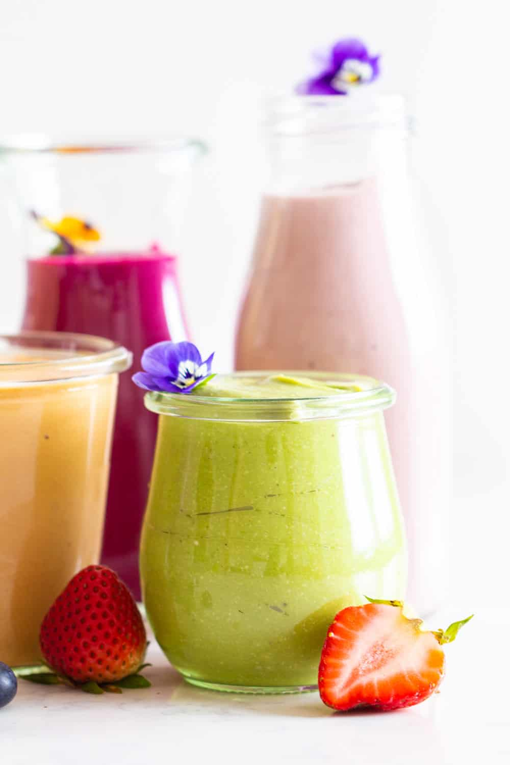 Healthy Smoothies for Breakfast in 4 different colors in different sized glass jars