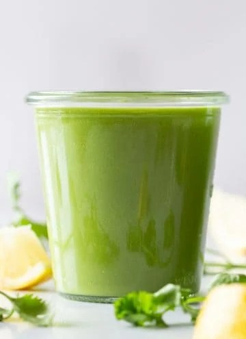A vibrantly green Keto Smoothie in a glass.
