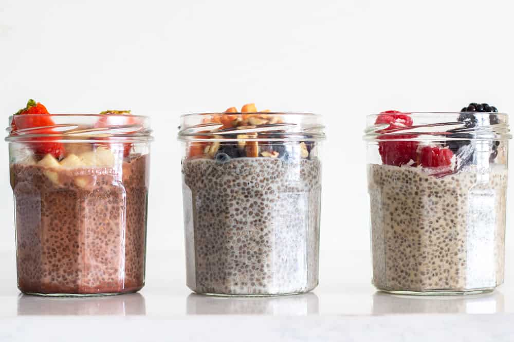 Chia Seed Pudding 3 ways in glass jars one next to the other.