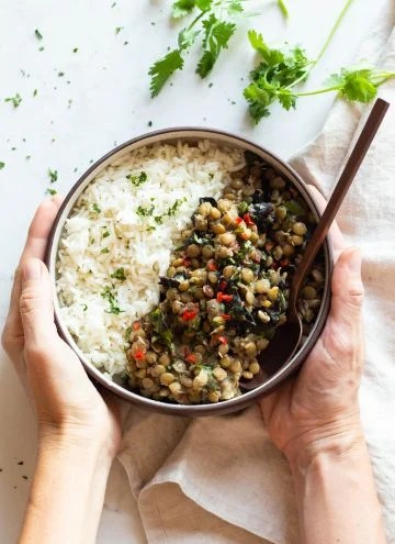 Lentils and Rice in a Bowl held in hands.