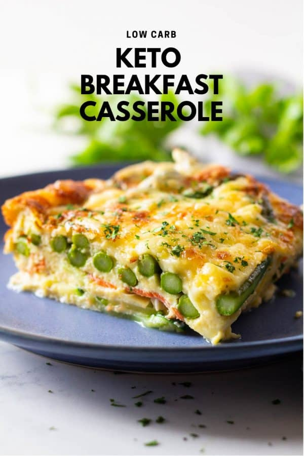 Piece of low carb breakfast casserole with asparagus and melted cheese on a blue plate