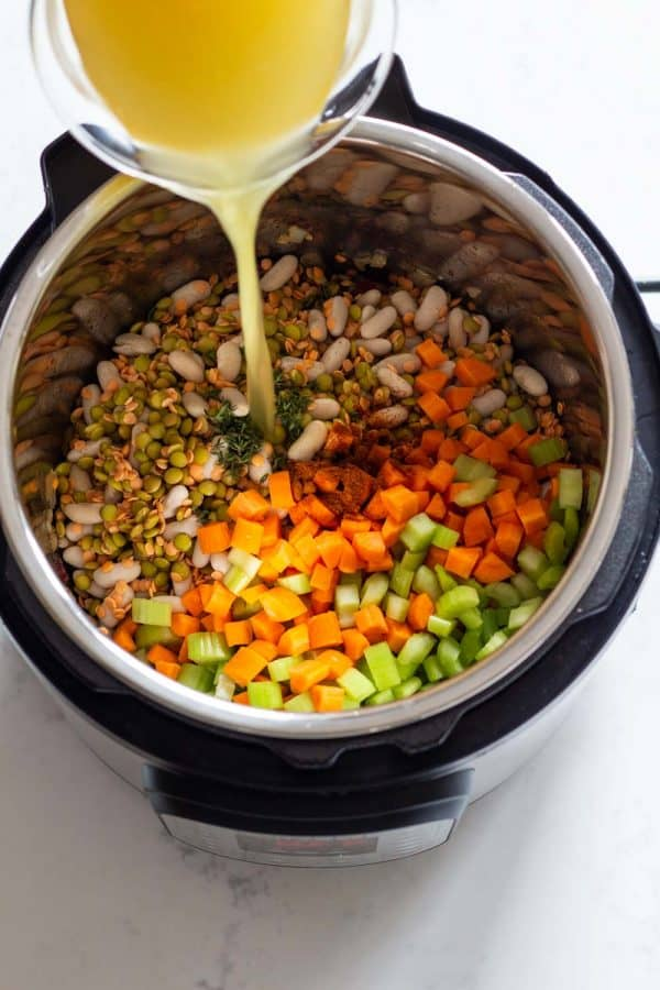 Ingredients for Instant Pot Lentil Soup shown in Pressure Cooker.
