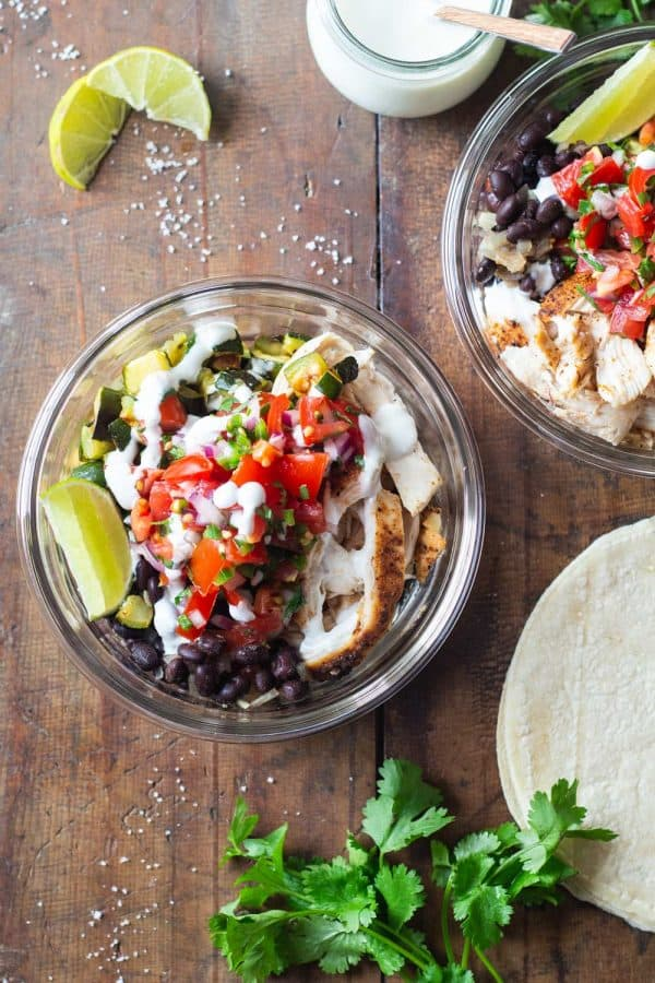 Mexican Chicken, Zucchini, Black Beans, Pico de Gallo in a round glass meal prep bowl.