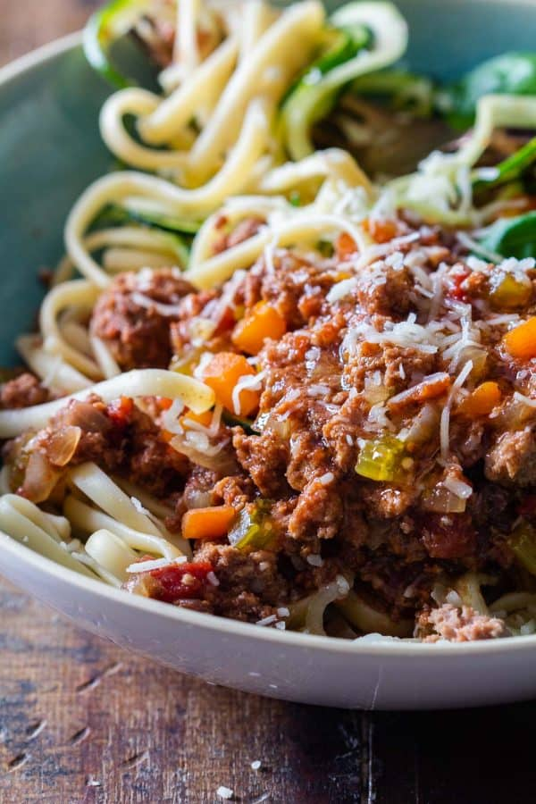 bowl of Slow Cooker Bolognese Sauce over zucchini noodles