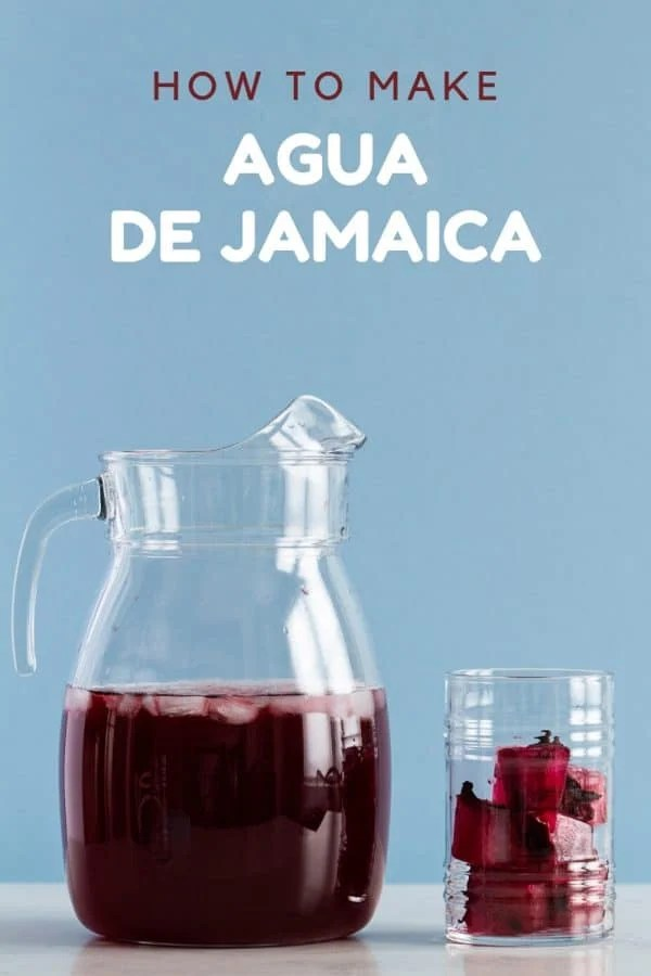 pitcher and drinking glass of Agua de Jamaica (hibiscus tea)