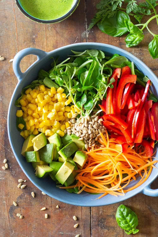 Summer Salad Ingredients in a blue salad bowl.