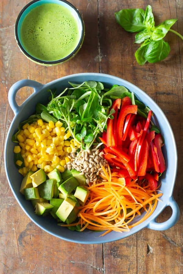 healthy summer salad with fresh vegetables in a light blue salad bowl
