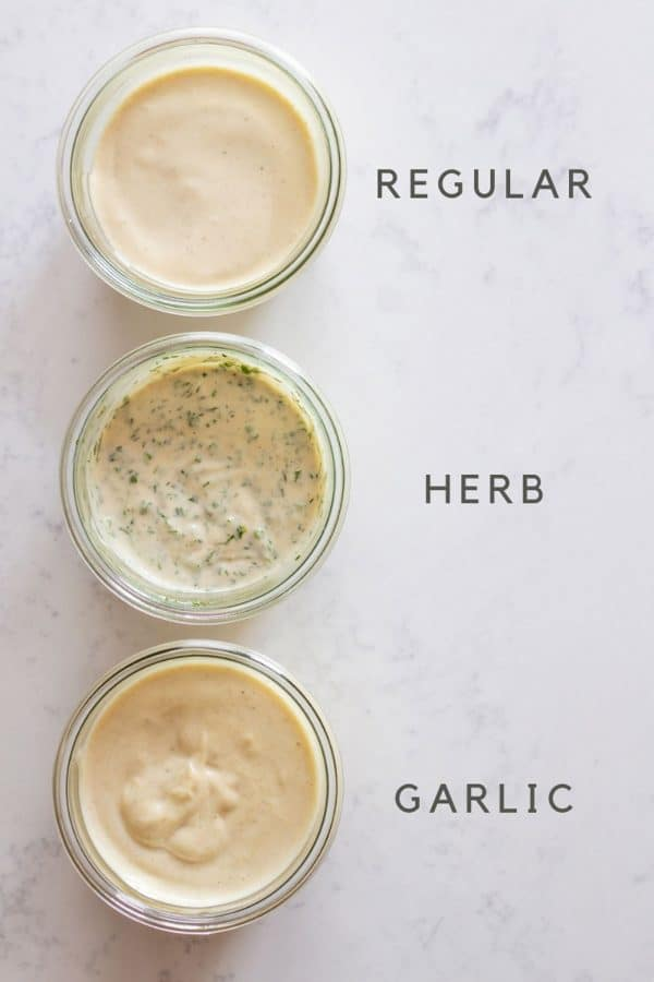 Regular homemade mayonnaise, herb mayonnaise, garlic mayonnaise in jars
