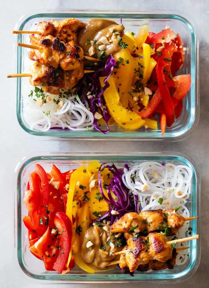 Chicken Satay with Peanut Sauce and sliced raw vegetables and rice noodles in meal prep containers