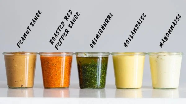 5 Keto Sauces in a jar, peanut sauce, roasted red pepper sauce, chimichurri, hollandaise, mayonnaise