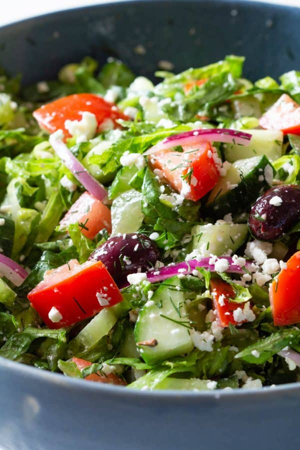 healthy salad with cucumber tomato onion and feta cheese