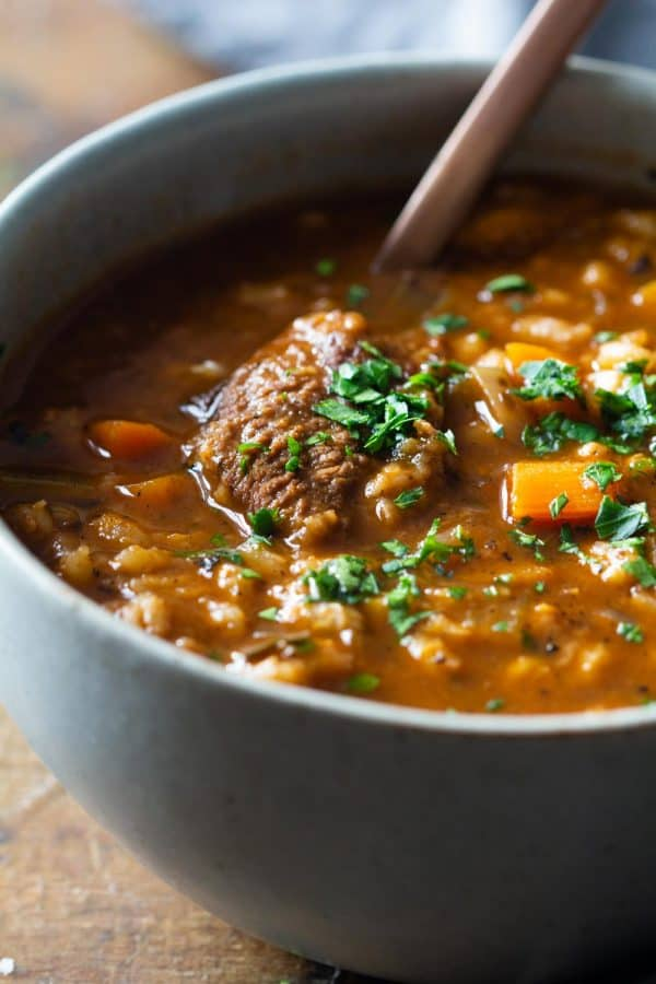 Closeup of texture of beef and barley soup