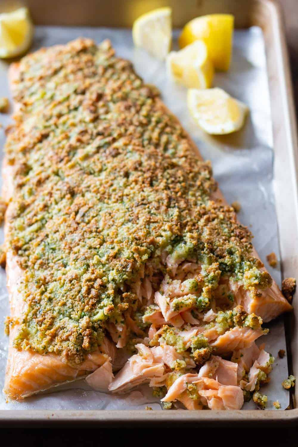 Almond curst baked salmon fillet on a baking sheet