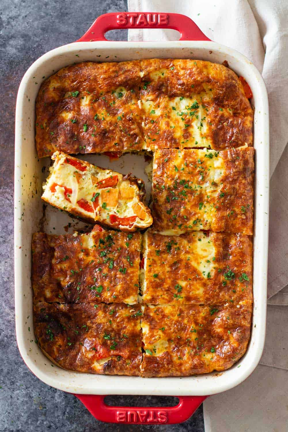 Sweet potato breakfast casserole in a red baking dish