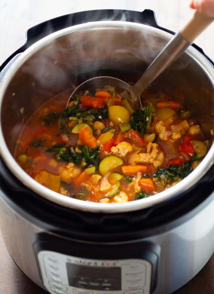 Vegetable Soup in an Instant Pot with a ladle in it