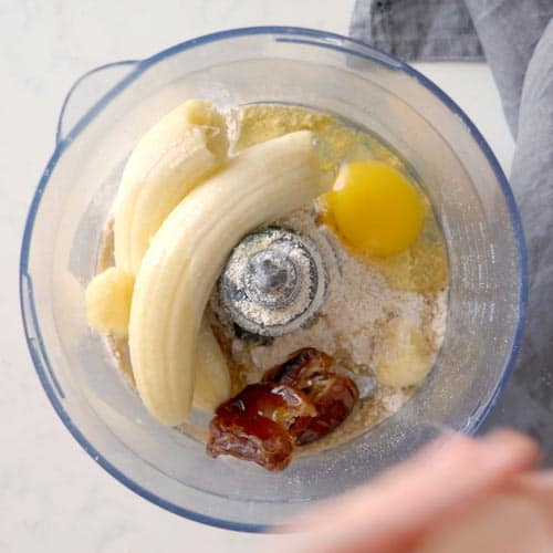 oat flour, bananas, dates, and an egg in a food processor