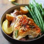 Rosemary Lemon Chicken with green beans and baby potatoes in a bowl.