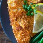 Breaded sole fish fillet on a plate.