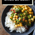 Coconut chickpea curry in a bowl and text overlay of recipe title for pinterest.