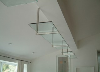 Glass shelf on steel support
