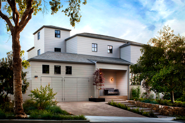 A simple and minimal yet welcoming exterior is achieved through few finish materials, asymmetrical volumes, no recessed cans, trims or moldings of any kinds.