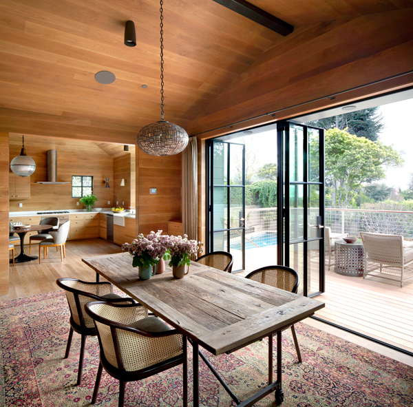Compelling features include the quality of light that plays on the oak surfaces and interior volumes developed by interior designer Sherry Williamson.