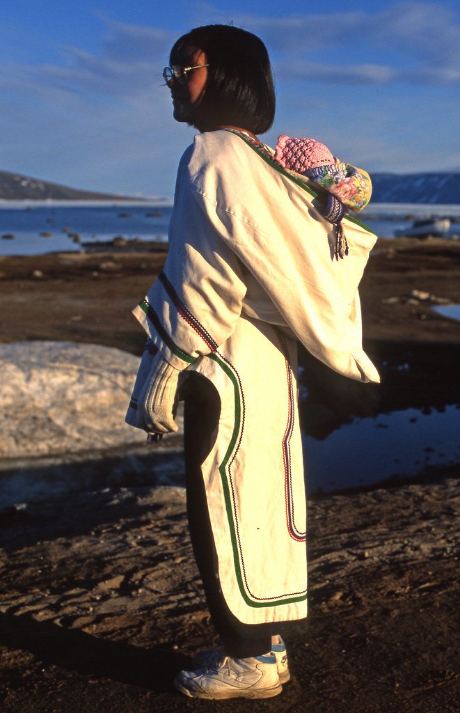 Inuit woman carrying her child