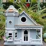 Springfield-Flower-Cottage-Birdhouse-is-a-Beautiful-Sky-Blue-with-White-Trim-Charming-Wood-Birdhouse-with-Beautiful-Flower-Pots-0-1