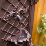 The-Manchester-Outdoor-Wall-Fountain-Weathered-Bronze-Water-Feature-for-Garden-Patio-and-Landscape-Enhancement-0-1