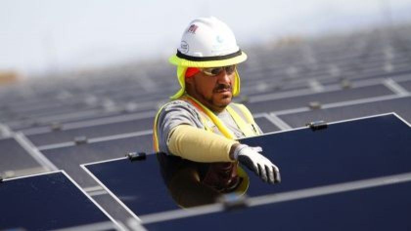 First solar inc, Image info: Photographer: Joshua Lott/Bloomberg, A worker installs photovoltaic solar panels in Arizona, U.S.
