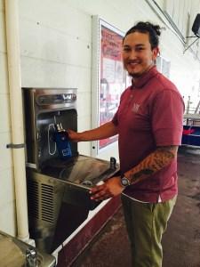 José Cerna NMSU  closeup using reusable bottle at elkay water fountain
