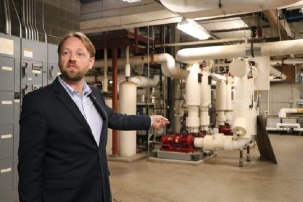 Jesse Warren, sustainability program manager for buildings and operations leads a tour of Clark Hall's retrofitted utilities. Credit: Charlotte Rene Woods | Charlottesville Tomorrow