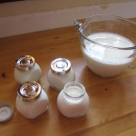 yogurt poured in glass containers