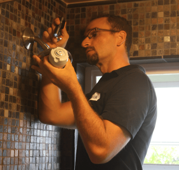 Pono Home installing high efficiency shower head