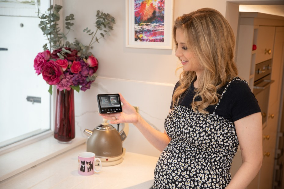 Smart meters will help to create seismic shifts in the energy, mobility, healthcare, and AI industries. Rachel Riley with a smart meter in-home display