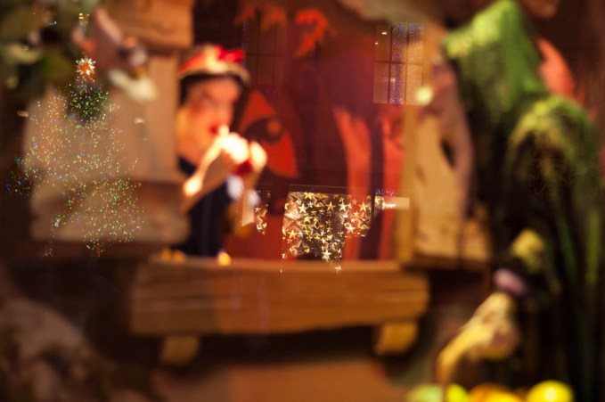 Snow White Sak's 5th Ave Window Display in New York with a reflection of Rockefeller Christmas Tree