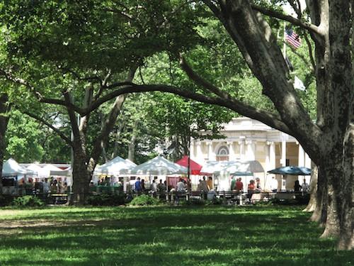 Summer farmers market through the trees
