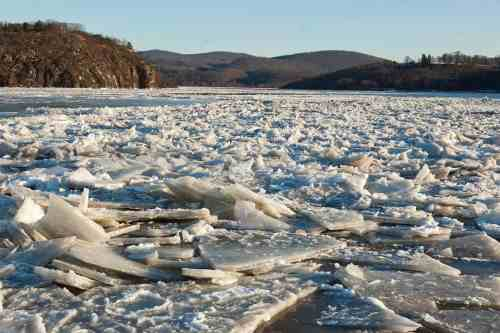 """Break up that cold. (Photo by Anthony Quintano from Hillsborough, NJ, """"Breaking The Ice On The Hudson River With United States Coast Guard Cutter Hawser"""" https://commons.wikimedia.org/w/index.php?curid=30566935)"""