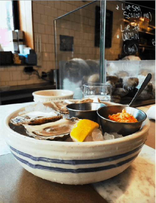 Bowl of Irish Point Oysters with lemon and dipping sauce